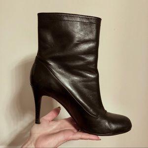 Coaches black leather zipper high heel booties
